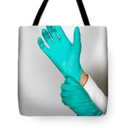 Doctor Putting On Gloves Tote Bag