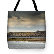 Dunstanburgh Castle On A Hill Under A Tote Bag