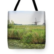 Dutch Landscape With Windmills And Cows Tote Bag by Carol Groenen