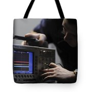 Electronics Technician Troubleshoots An Tote Bag