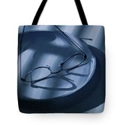 Eye Glasses On A Plate In Blue Tote Bag