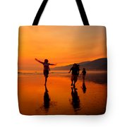 Family Running In The Beach At Sunset Tote Bag