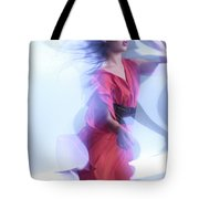 Fashion Photo Of A Woman In Shining Blue Settings Wearing A Red  Tote Bag