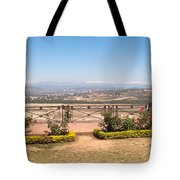 Fence And Garden Overlooking A Beautiful Vista Of Valley And Snow-capped Mountains Tote Bag