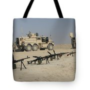 Firearms Sit Ready On A Firing Range Tote Bag
