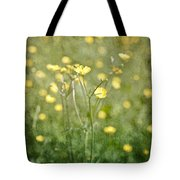Flower Of A Buttercup In A Sea Of Yellow Flowers Tote Bag
