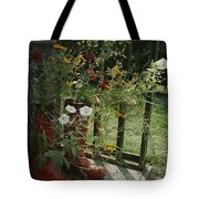Flowers Bloom From An Unlikely Place-a Tote Bag
