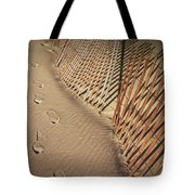 Footprints On The Beach Along A Fence Tote Bag