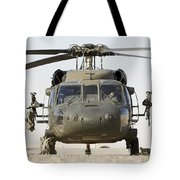 Front View Of A Uh-60l Black Hawk Tote Bag by Terry Moore