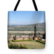 Garden With Some Beautiful Roses Overlooking A Valley With Snow Capped Mountains In The Background Tote Bag