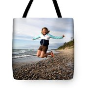 Girl Jumping At Lake Superior Shore Tote Bag