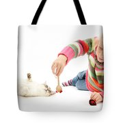 Girl Playing With Cat Tote Bag