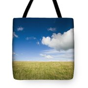 Grassy Field On Hill With Blue Skies Tote Bag