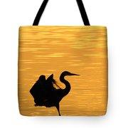 Great Blue Heron Landing In Golden Light Tote Bag