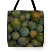 Green Plums Fill A Bin Outside A Local Tote Bag