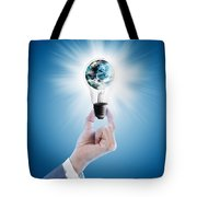 Hand Holding Light Bulb With Globe  Tote Bag