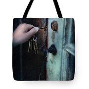 Hand Putting Vintage Key Into Lock Tote Bag