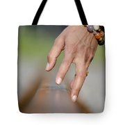Hand Touching A Railroad Track Tote Bag