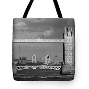 Helicopters Flying Through Tower Bridge Tote Bag
