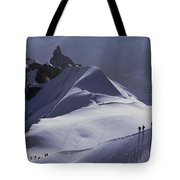 Hikers Follow Paths Across The Snow Tote Bag