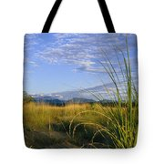 Hills Loom In The Distance Tote Bag