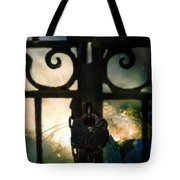 Hooded Figure By A Fire Tote Bag