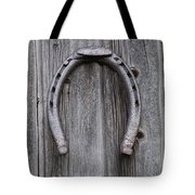 Horseshoe Hanging On A Wooden Wall Iron Tote Bag