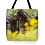 House Behind Yellow Flowers Tote Bag