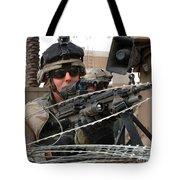 Iraqi And U.s. Soldiers Patrol The Al Tote Bag