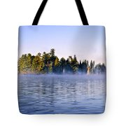 Island In Lake With Morning Fog Tote Bag