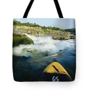 Kayak Noses Its Way Toward A Waterfall Tote Bag