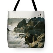 Kayaker Carries Boat Up The Rocks Tote Bag