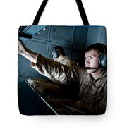 Kc-10 Extender Boom Operator Adjusts Tote Bag