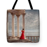 Lady In Red Gown By The Sea Tote Bag