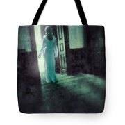 Lady In White Gown Walking Through A Mysterious Doorway Tote Bag