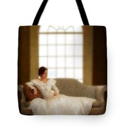 Lady Sitting On Sofa By Window Tote Bag