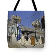 Laundry Hangs In The Courtyard Tote Bag by Stocktrek Images