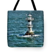 Lighthouse On The Blue Sea Tote Bag
