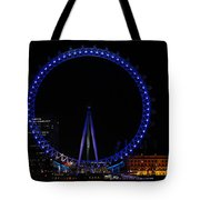 London Eye All Done Up In Blue Light In The Night With A Small Reflection In The Thames Tote Bag