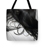 Long Dark Hair Of A Woman On White Pillow Tote Bag