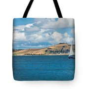 Luxury Yacht Sails In Blue Waters Along A Summer Coast Line Tote Bag