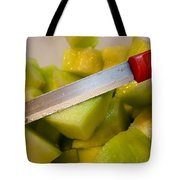 Macro Photo Of Knife Over Bowl Of Cut Musk Melon Tote Bag