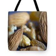 Macro Shots Of Various Dry Fruit Items Such As Almonds And Walnuts And Raisins Tote Bag