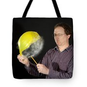 Man Popping A Balloon Tote Bag