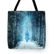 Man Walking Through Snowy Woods Tote Bag