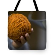 Mans Hand Holds Ball Of Orange Wool Tote Bag
