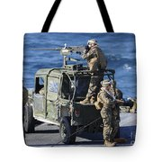 Marines Provide Security Aboard Tote Bag