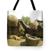 Midshipmen Maneuver Through A Mud Pit Tote Bag