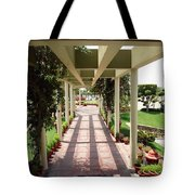 Mix Of Light And Shade Under A Partially Covered Pathway With Pillars Tote Bag