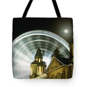 Moon Rising Behind Big Wheel Tote Bag